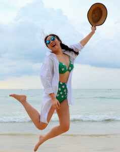 lady jumping for joy on a beach because she has an avirtual PA that helps manage her busy life